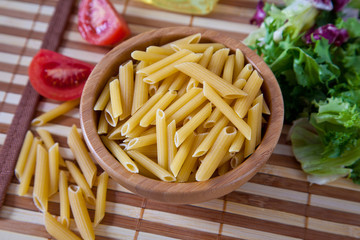 Uncooking italian pasta in bowl