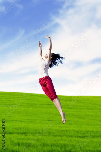 Woman dancing in nature