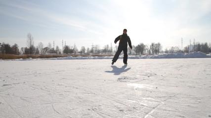 Man on the skates  on a lake