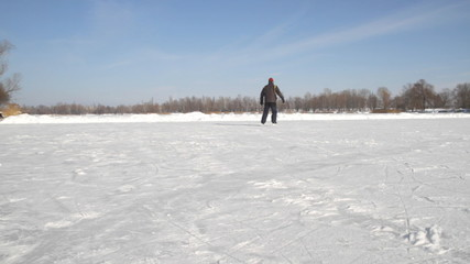 Man on the skates  on a lake