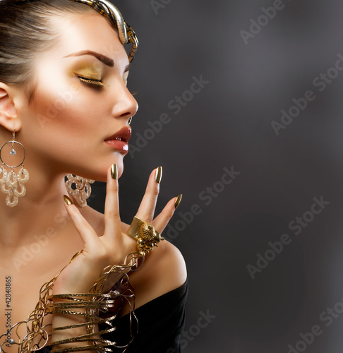 Fashion Girl Portrait. Golden Makeup