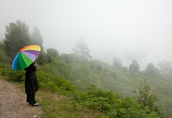 Alone in the Fog with colorful umbrella