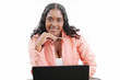 Portrait of a beautiful young black woman working on laptop