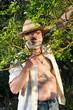 a farmer man in his garden