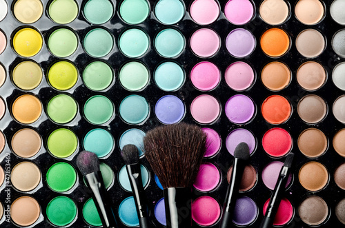 Multi colored make-up with brushes