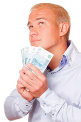 A young businessman with russian money in the hands.