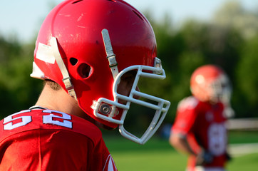 american football player wearing red helmet