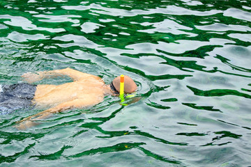 Beach man snorkeling on the sea