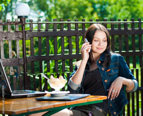 Young pretty woman speaking on mobile phone