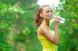 Woman drinking water after fitness