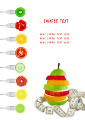 Dietary menu with vegetables and fruit on forks