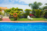 pool side in tropical garden