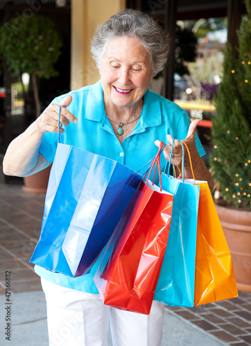 Senior Shopper Inspects Bags
