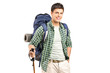 A hiker with backpack and hiking poles posing