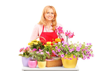 A mature female florist and flowers