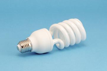Novel fluorescent light bulb on blue background