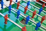 Tabletop football with red and blue figures poster