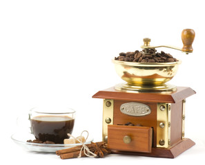 Coffee grinder and little coffee cup