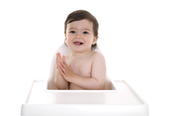 Baby excited in highchair