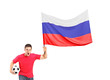 An euphoric fan holding a ball and waving a russian flag