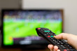 Leinwandbild Motiv Watching soccer game on TV