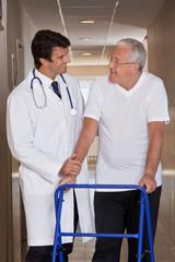 Doctor helping Patient use Walker
