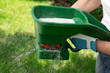 Leinwandbild Motiv Fertilizing Lawn