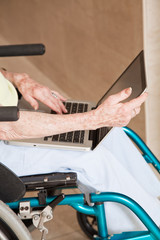 Woman on Wheelchair Using Laptop