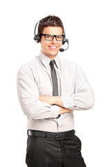 A male customer service operator wearing a headset