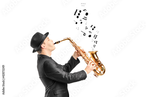 A male playing on saxophone and notes coming out