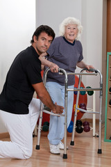 Therapist helping Patient use Walker