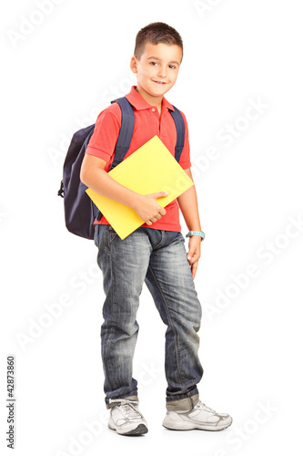 Full length portrait of a happy school boy with backpack holding
