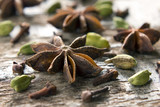 Spices anise, cloves and cardamom on the vintage wooden surface