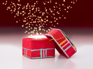 Red gift box with fairy dust