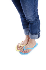 Woman Wearing Mismatched Flip Flops Isolated on White