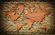 Vintage world map carving on wall texture.