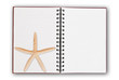 Notebook isolated on the white with star fish.