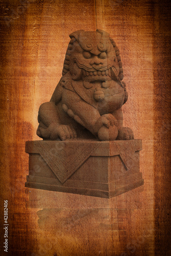 Chinese statue on the wood texture.