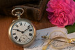 Antique pocket watch and old glasses