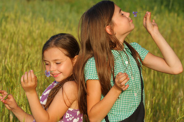 two young girls playing outdoor
