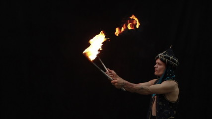 Fire breather on a black background