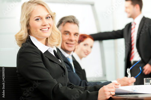 Business people - presentation within a team