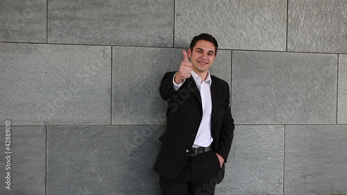 Business man holding thumbs up