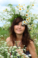 Portrait of the beautiful girl  in diadem of wildflowers