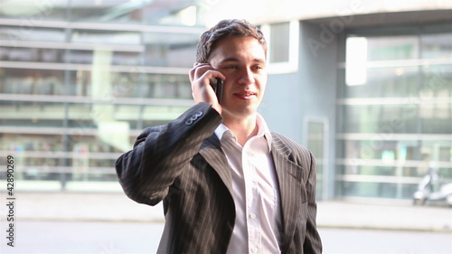 Urban businessman talking with smartphone