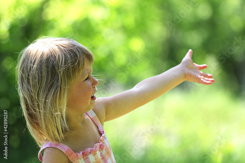 Beautiful little girl crying on the nature