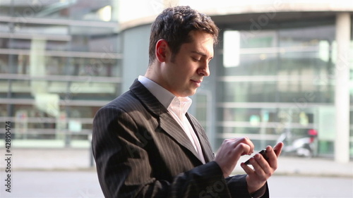 Manager using smartphone for orientation