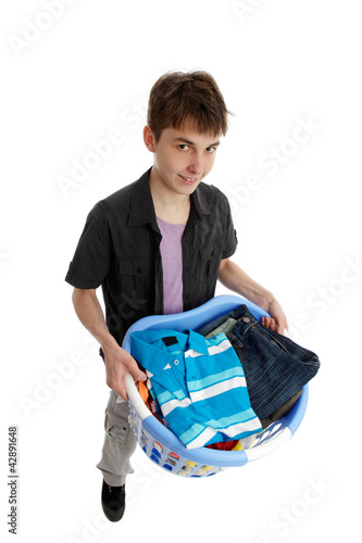 Teenager holding a basket of laundry