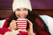 Beautiful woman having hot drink