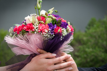 Engagement flower on hand image vignetted